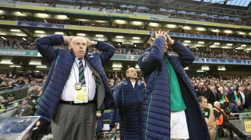 Ireland Manager Mick Kearney and Brian O'Driscoll watch as All Blacks's score a try through Ryan Crotty in the last minute. Photograph: Billy Stickland/Inpho