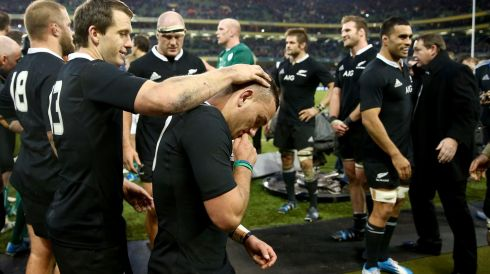 Ben Smith (left) congratulates Aaron Cruden (centre) of the All Blacks.  Photograph: Phil Walter/Getty Images
