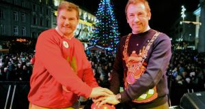 Lord Mayor of Dublin Cllr Oisin Quinn, pictured with Richard Guiney of Dublintown.ie, switched on the lights of the Christmas tree in O'Connell St. last nightPhotograph: Dave Meehan