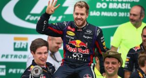Race winner Sebastian Vettel  celebrates on the podium with Red Bull team-mates following the Brazilian Formula One Grand Prix  in Sao Paulo. Photograph:  Clive Mason/Getty Images