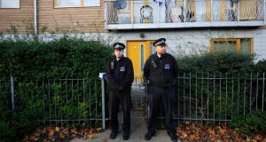 Police stand guard in front of a property in Brixton, south London. Two people who allegedly held three women as slaves in their south London home for more than 30 years had been arrested previously in the 1970s, but did not say why. Photograph: EPA/Facundo Arrizabalaga