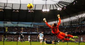 Manchester City's Alvaro Negredo  scores his side's fifth goal during their English Premier League clash against Tottenham Hotspur at the Etihad Stadium in Manchester.