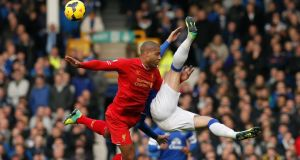 Liverpool's Glen Johnson challenges Everton's Ross Barkley during their English Premier League soccer match at Goodison Park. Photograph: Phil Noble/Reuters