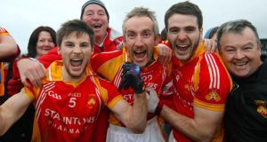Castlebar Mitchels capatin Donal Newcombe, Kevin Filan and Gerard McDonagh celebrate their provincial final victory. Photograph: Mike Shaughnessy/Inpho