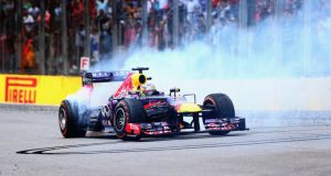 Sebastian Vettel of Germany and Infiniti Red Bull Racing performs donuts in his car after winning the Brazilian Formula One Grand Prix at Autodromo Jose Carlos Pace  in Sao Paulo, Brazil. Photograph: Clive Mason/Getty Images