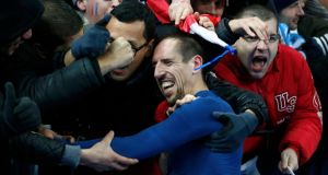 Franck Ribery celebrates with French supporters after their 2014 World Cup  play-off win over  Ukraine at the Stade de France in Saint-Denis last week. Photograph: Charles Platiau/Reuters