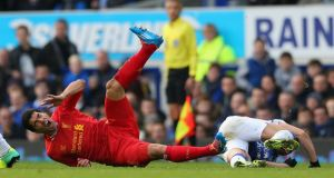 Luis Suarez of Liverpool after being fouled by Kevin Mirallas of Everton  at Goodison Park. Photograph:  Alex Livesey/Getty Images