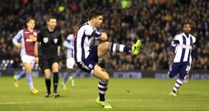 West Brom's Shane Long opens the scoring in last night's Premier League game against Aston Villa at the Hawthorns. Photograph: Nick Potts/PA