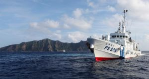 Japan Coast Guard vessel PS206 Houou sails in front of Uotsuri island, one of the disputed islands known as the Senkaku in Japan and the Diaoyu in China, in the East China Sea in this August 18th, 2013 file photo. Photograph: Ruairidh Villar/Reuters