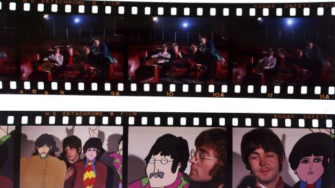 Undated handout photo issued by Omega Auctions of some of the unseen and unpublished images of The Beatles from late 1967/early 1968, during a visit to the studios where the animations for their film Yellow Submarine were created. The collection of around 150 images will be auctioned on Friday in Stockport and are expected to sell for over £40,000. Photograph: Omega Auctions/PA Wire