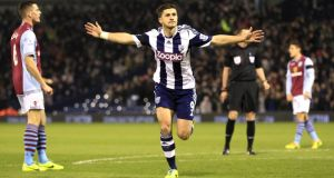 West Bromwich Albion's Shane Long celebrates scoring his teams opener, hist first, against  Aston Villa at The Hawthorns. Photograph: Nick Potts/PA Wire