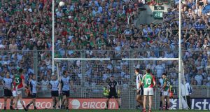 Mayo's Cillian O'Connor kicks Mayo's last score in injury time of the All-Ireland football final against Dublin. Photograph: Lorraine O'Sullivan/Inpho