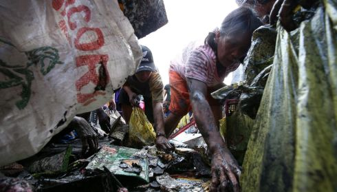 Searching in the rubble in the typhoon devastated city of Tacloban. Photograph: Photograph: Dennis M. Sabangan/EPA