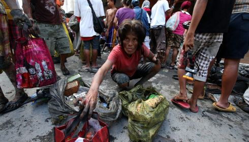 A Filipino man  pictured in the devastated city of Tacloban today. Photograph:  Dennis M. Sabangan/EPA