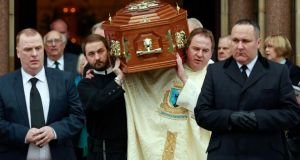 Friends and colleagues carry the coffin of Father Alec Reid after his funeral service at the Clonard Monastery in west Belfast today. Photograph: Cathal McNaughton/Reuters.