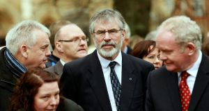 Sinn Féin President Gerry Adams (centre) and Northern Ireland Deputy First Minister Martin McGuinness (right) attend the funeral of Father Alec Reid in  the Clonard Monastery in west Belfast today. Photograph: Cathal McNaughton/Reuters.