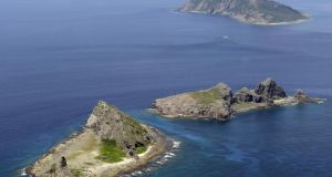 The tiny islands in the East China Sea, called Senkaku in Japan and Diaoyu in China. China said yesterday it had monitored two unarmed US bombers that flew over the East China Sea in defiance of its declaration it was exercising greater military control over the area. Photograph: AP/Kyodo News.