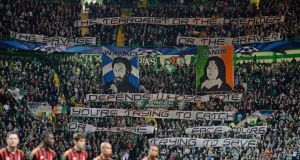 Celtic supporters hold up  banners ahead of the  Champions League  match against AC Milan. Photograph: Jeff J Mitchell/Getty Images