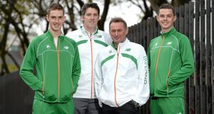 Ireland team members Michael Mulhare left and David McCarthy (right) flank Athletics Ireland high performance director Kevin Ankrom (second left) and national endurance coach Chris Jones at a press conference ahead of the 20th European Cross Country Championships in Belgrade, Serbia, on Sunday. Photograph: sportsfile
