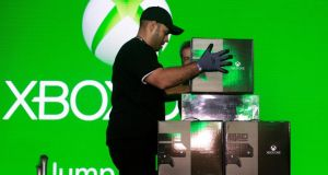 Workers arrange new Xbox game console boxes on stage during the midnight launch event in New York last Friday.  Photograph: Victor J Blue/Bloomberg