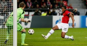 Antonio Valencia turns home Manchester United's opening goal during the Champions League game against Bayer Leverkusen   at the BayArena. Photograph: Wolfgang Rattay/Reuters