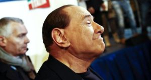 Silvio Berlusconi after delivering a speech to his supporters outside Palazzo Grazioli, his private residence, in Rome yesterday. Photograph: EPA/Guido Montani