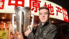 It's a long way from Ballyea to here – Clare's Tony Kelly, with the Liam MacCarthy cup  near the team hotel on Minsheng Road, Shanghai during the GAA GPA All Star Tour. Photo: Ray McManus/Sportsfile