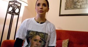 Eugenia Tymoshenko, daughter of jailed Ukrainian politician Yulia Tymoshenko, wearing a T-shirt with her mother's photograph during an interview on the sidelines of an Eastern Partnership summit. Photograph: Virginia Mayo/AP Photo