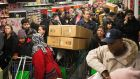 Customers push loaded shopping carts through crowded aisles as they look for bargains during a Black Friday discount sale inside an Asda supermarket in Wembley, London. Photograph: Simon Dawson/Bloomberg