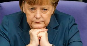 Angela Merkel: approved a coalition pact this week that strengthens workers' rights, introduces a minimum wage, augments pension rights, and further bolsters regulation in the housing market. Photograph:  Fabrizio Bensch/Reuters