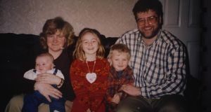 The Burke family in 1996: Amy Burke (centre) with her mother, Mary, holding her brother Michael, and her father Derek holding her brother David