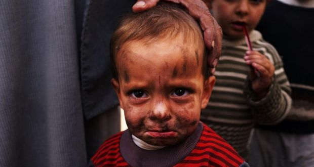 "A displaced Syrian child in a makeshift camp for refugees only miles from the Syrian border in Majdal Anjar, Lebanon. ""If we do not act quickly, a generation of innocents will become lasting casualties of an appalling war,"" the UNHCR report said. Photograph: Spencer Platt/Getty Images"