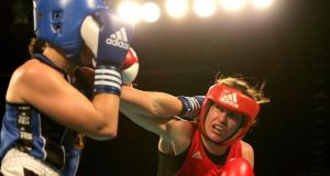 Katie Taylor (red) and Caroline Veyre in action at The Mansion House on Friday night. Photograph: Morgan Treacy/Inpho