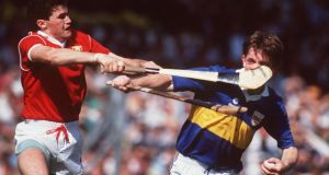 "Denis Walsh and Nicky English clash in the 1990 Munster hurling final in Thurles: ""James Meehan took this at the Munster final in 1990. It's just one of those moments that happen in hurling and that you would never see now because of the helmets. Hurling photographs have become a lot less interesting."""