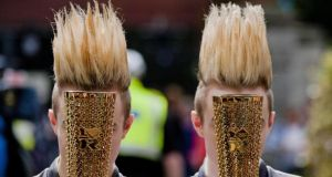 "Jedward: ""That was when the Olympic torch came through Dublin last year. You have to hand it to Jedward, they never miss an opportunity. They saw where the photographers were and lined up themselves. I think it's very clever by them."""