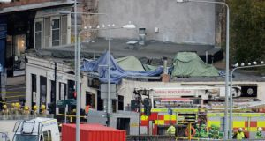 Rescue workers attend the scene at a pub on Stockwell Street where a police helicopter crashed on the banks of the River Clyde. Photograph:  Jeff J Mitchell/Getty Images