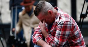 Paul Watt, a regular at the Clutha pub, reacts at the police cordon set up around the site of a helicopter crash on the Clutha in the centre of Glasgow. Photograph: Andrew Winning/Reuters