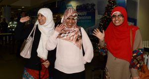 Halawa sisters [from left to right] Omaima (21),Fatima (23) and Somaia (28) are greeted  at Dublin Airport this morning following their detention in Egypt .Photograph: Cyril Byrne /The Irish Times