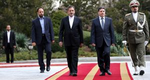 Iranian vice president Eshagh Jahangiri, center left, walks with Syrian prime minister Wael Nader al-Halqi, center right, during a welcoming ceremony at Tehran's Saadabad Palace.