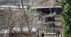 Firefighters and rescue personnel on the scene of a reported fatal passenger train derailment near the Spuyten Duyvil station in the Bronx neighborhood of New York, New York. Photograph: Andrew Gombert/EPA