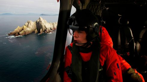 Air Corps Capt Pat Keavney on the approach to Skellig Michael as seven tonnes of material were airlifted to Skellig Michael for essential renovation works on the Unesco world heritage site.  Photograph: Brian Lawless/PA Wire