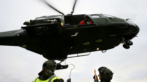A member of the Air Corps preparing a load for transporting from Valentia Island to Skellig Michael, using a Agusta Westland AW139 helicopter. Photograph: Brian Lawless/PA Wire
