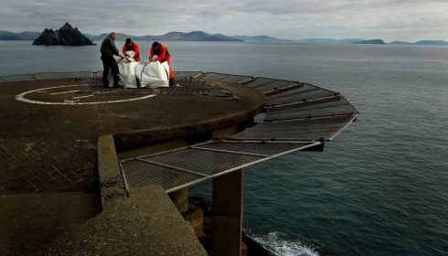 Members of the Air Corps as the prepare a load for collection on Skellig Michael, after seven tonnes of material have were airlifted to Skellig Michael for essential renovation works on the Unesco world heritage site. Photograph: Brian Lawless/PA Wire