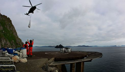 Air Corps Agusta Westland AW139 helicopter delivering a load of stone which will be used for repairs to the walls on the road leading to the Lighthouse on Skellig Michael.  Photograph: Brian Lawless/PA Wire