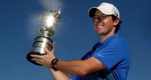 A jubilant Rory McIlroy holds aloft the Australian Open trophy after victory during day four of the prestigious event at Royal Sydney Golf Club. Photograph:  Mark Metcalfe/Getty Images