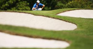 Rory McIlroy lines up a putt on the 8th green during day four of the Australian Open.  Photograph: Matt King/Getty Images)