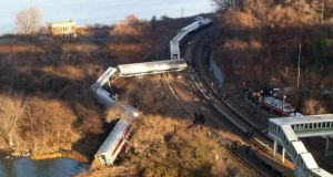 Cars from a Metro-North passenger train are scattered after the train derailed in the Bronx neighbourhood of New York this morning. Photograph: Edwin Valero/AP