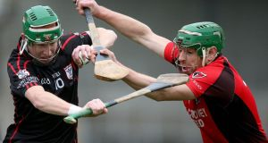 Mount Leinster Rangers' Paul Coady holds off the challenge of Lar Prendergast of Oulart-The Ballagh during yesterday's Leinster club hurling final at Nowlan Park. Photograph: James Crombie/inpho