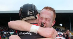 Mount Leinster's Jack Murphy and Paul Coady celebrate after yesterday's game at Nowlan Park. Photograph: James Crombie/Inpho