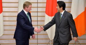 Taoiseach Enda Kenny  shakes hands with Japanese prime minister  Shinzo Abe at the start of their talks at Mr Abe's official residence in Tokyo today. Photograph: Reuters
